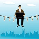 Businessman sitting on a clothesline and using a laptop