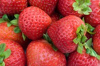 Close up abstract of a basket of strawberries in garden in Norfolk