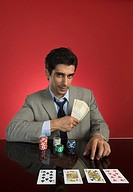 Portrait of a man gambling in a casino