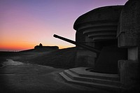 Large gun battery with gun still intact, above Omaha beach just before sunrise