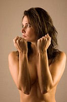 Dark-haired woman, naked upper body
