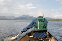 Senior man canoeing Loch Lomond in Scotland