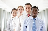 Business people standing in a row and smiling at the camera together (thumbnail)