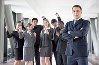 Business people standing and gesturing to be successful with smile together