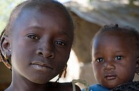 Portrait of young Gambian girl with baby sibling, Bakadagi, The Gambia