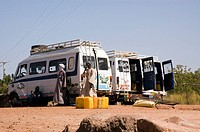 Minibusses waiting for the ferry to go to Janjanbureh