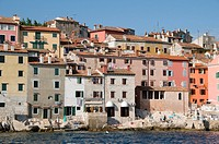 An urban landscape view of the crowded buildings in the old town of Rovinj in Croatia showing the variety of colours