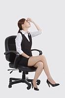 Young office lady sitting on chair and closing eyes of exhaustion