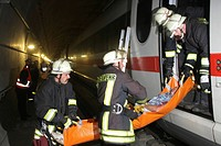 Firefighters moving a stretcher, rescue drill conducted in an ICE high-speed or bullet train tunnel, Germany