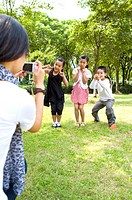 Children in park, posing for taking pictures