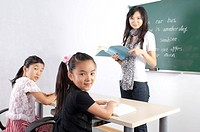Child, Children studying in the classroom and looking at the camera with teacher (thumbnail)