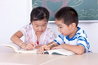 Child, Children studying and discussing in the classroom together