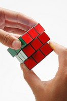 Human hands playing a puzzle cube