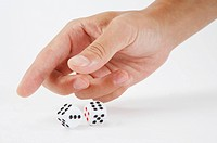 Human hand playing with dice
