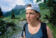 Young woman wearing a reversed cap, backwards hat, sweating profusely, Karwendel Range, Tyrol, Austria, Europe