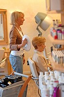 elderly woman at the barber