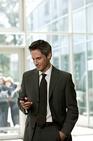 Business man with a mobile phone in the lobby