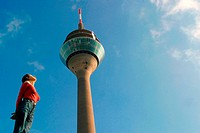 woman looking at Television Tower in Dusseldorf, Germany, North Rhine_Westphalia, Duesseldorf
