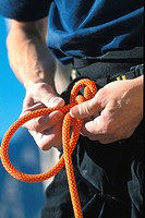 A man knotting a climbing rope, Close_up