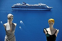 Mannequin dolls from tourist shop and cruising vessel at Fira town, Santorini island, Greece