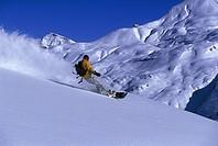 Man snowboarding, Zuers, Arlberg, Austria