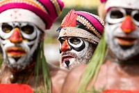Men with facial painting at Singsing Dance, Lae, Papua New Guinea, Oceania
