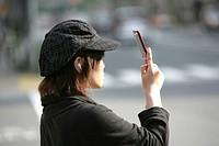 Japan, Tokyo: Mobile phone user.