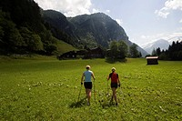 Two women nordic walking over meadow, Koetschachtal, Bad Gastein, Gastein Valley, Salzburg, Austria