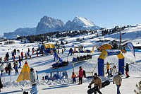 Tourists at a snowy Ski Resort in the sunlight, Alpe di Siusi, Valle Isarco, South Tyrol, Italy, Europe