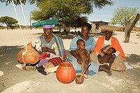 Women sitting in village square, Sehitwa, Botswana, Africa