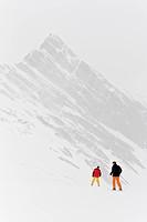 Two skiers in fog, Hintertux, Tyrol, Austria