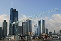 Crane in front of the skyscrapers in the banking quarter of Frankfurt Main, Hesse, Germany