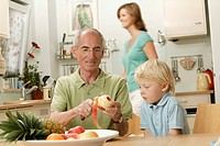 Grandpa peels an apple for his grandson