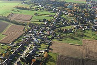 Urbanisation at the border of agricultural area from the air, Belgium