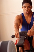 Man on exercise machine