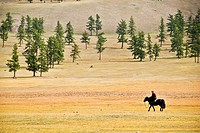 Mongolian riding a horse, Khovsgol nuur lake, Mongolia