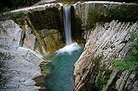 Waterfall. Scaglia formations of limestone rock at a small waterfall in the river Breggia. The Geoparc of the Breggia gorges in southern Ticino, Switz...