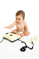 little child with telephone apparat