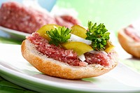 Bread roll with ground pork, onions, gherkins and parsley