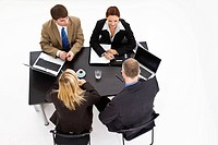 Business meeting, two women and two men, high-angle shot