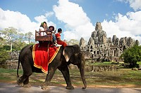 Cambodia-No  2009 Siem Reap City Angkor Temples W H  Bayon Temple within Angkor Thom Tourists on elephants.