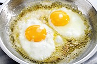 Eggs frying in fat