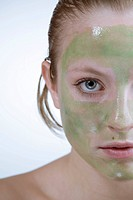 Young woman, peel_off mask on her face