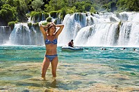 Woman, 35 years old, bathing in the Krka waterfalls, Krka National Park, Dalmatia, Croatia, Europe