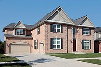 Brick house in suburbs with black shutters