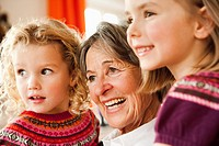 grandma and grandchildren smiling