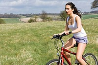girl on bicycle in countryside