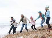 Generations Strolling on Beach