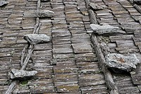 A roof made of wooden shingles is fixed with heavy stones, Schnalstal, South Tyrol, Italy