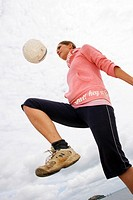 A woman with a soccer ball